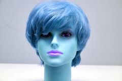 Mannequin head with blue wig royalty free stock photos