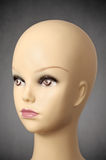 Mannequin head on dark grey background Royalty Free Stock Photos