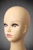 Mannequin head on dark grey background Royalty Free Stock Photos