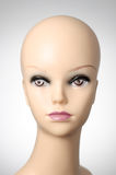 Mannequin head on grey background. Closeup of a female mannequin head Royalty Free Stock Photos