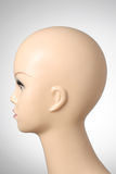 Mannequin head on grey background. Closeup of a female mannequin head Royalty Free Stock Photography