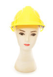 Mannequin head wearing builders hard hat Royalty Free Stock Image