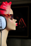 Mannequin with headphones Stock Images