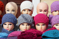 Mannequin heads with knitted winter caps Stock Photos