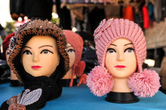 Mannequin heads on a table with hats Stock Image