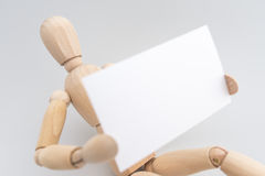 Mannequin Holding Card Royalty Free Stock Photo