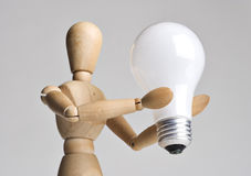 Mannequin holding a light bulb Stock Photo