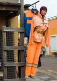 Mannequin im orange Overall Stockbild