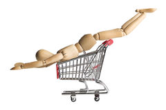Mannequin In A Shopping Cart Royalty Free Stock Photos