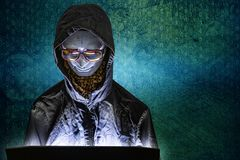 Mannequin and laptop in dark tone for cyber crime content. The Mannequin and laptop in dark tone for cyber crime content royalty free stock photos