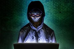 Mannequin and laptop in dark tone for cyber crime content. The Mannequin and laptop in dark tone for cyber crime content stock photo