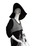 Mannequin with large hat and black and white dress Stock Image