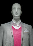 Mannequin In Light Gray Jacket & Red Sweater. Mannequin in a light gray jacket, red sweater and white shirt on black background. Clipping path included Royalty Free Stock Image