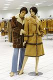 Mannequin in magazine. On sale of the winter clothing Stock Image