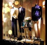 Mannequin male in beautiful business suit, standing dummy in shop window with bow tie on neck stock images