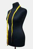 Mannequin and measuring tape Royalty Free Stock Image