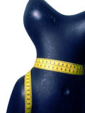 Mannequin with measuring tape. Plastic mannequin close-up view with a measuring tape around the waist Stock Images