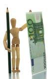 Mannequin met potlood en geld Stock Afbeeldingen