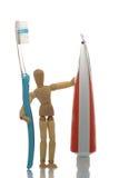 Mannequin met tandenborstel en tandpasta Stock Foto's