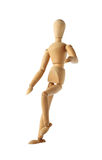 Mannequin old wooden dummy acting about soccer isolated on white. Background Stock Image