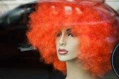 Mannequin with orange wig Royalty Free Stock Photo