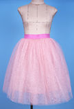 Mannequin in pink princess skirt on blue background Royalty Free Stock Photography