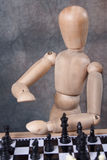 Mannequin playing chess royalty free stock images