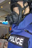 Mannequin in Police uniform and wearing safety mask. Anti armed armor army assault background black white photo body cop counter enforcement equipment face stock images