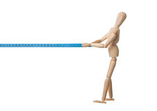 Mannequin pulling a measuring tape Royalty Free Stock Image