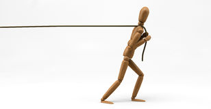 Mannequin Pulling Rope. 3D image of a wooden mannequin pulling a rope Stock Images