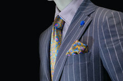 Mannequin in purple striped suit, yellow silk tie & handkerchief. Close up of a mannequin in purple striped suit, striped shirt, yellow silk tie and handkerchief Royalty Free Stock Image