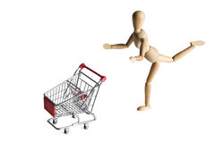 Mannequin pushing a shopping cart Stock Photo