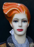 Mannequin with red lips and orange hair Stock Photos