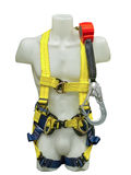 Mannequin in safety harness equipment. And lanyard for work at heights isolated on a white background Stock Image