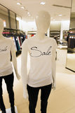 Mannequin with sale t-shirt in clothes shop Royalty Free Stock Photography