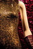 Mannequin in a sequins dress. And leather gloves in a retail store window Royalty Free Stock Photo