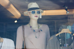 Mannequin in a shop window Stock Photography