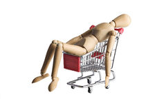 Mannequin in a shopping cart royalty free stock image