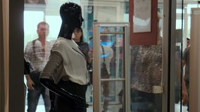 Mannequin on a show-window at a background people stock footage