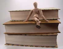 Mannequin Sitting on Books. Photo of Mannequin Sitting on Books royalty free stock photography
