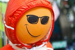 Mannequin with smile balloon head. Near clothing store Stock Image