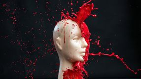 Mannequin splashed with red paint. Mannequin splashed with deep red paint stock photos