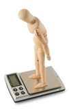 Mannequin standing on the digital scale Stock Photo
