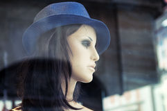 Mannequin in store window. Royalty Free Stock Photo