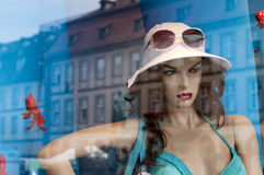 Mannequin in store window. Stock Photos