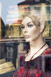 Mannequin in store window. Stock Images