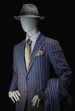 Mannequin in Striped Suit and Hat. Mannequin in purple striped suit, striped shirt, yellow silk tie and handkerchief and gray hat. Clipping path included Royalty Free Stock Photos