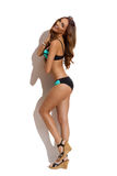 Mannequin In Swimsuit Against Sunny White Wall photo stock
