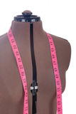 Mannequin with tape measure Stock Photography