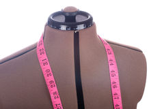 Mannequin with tape measure Royalty Free Stock Photography